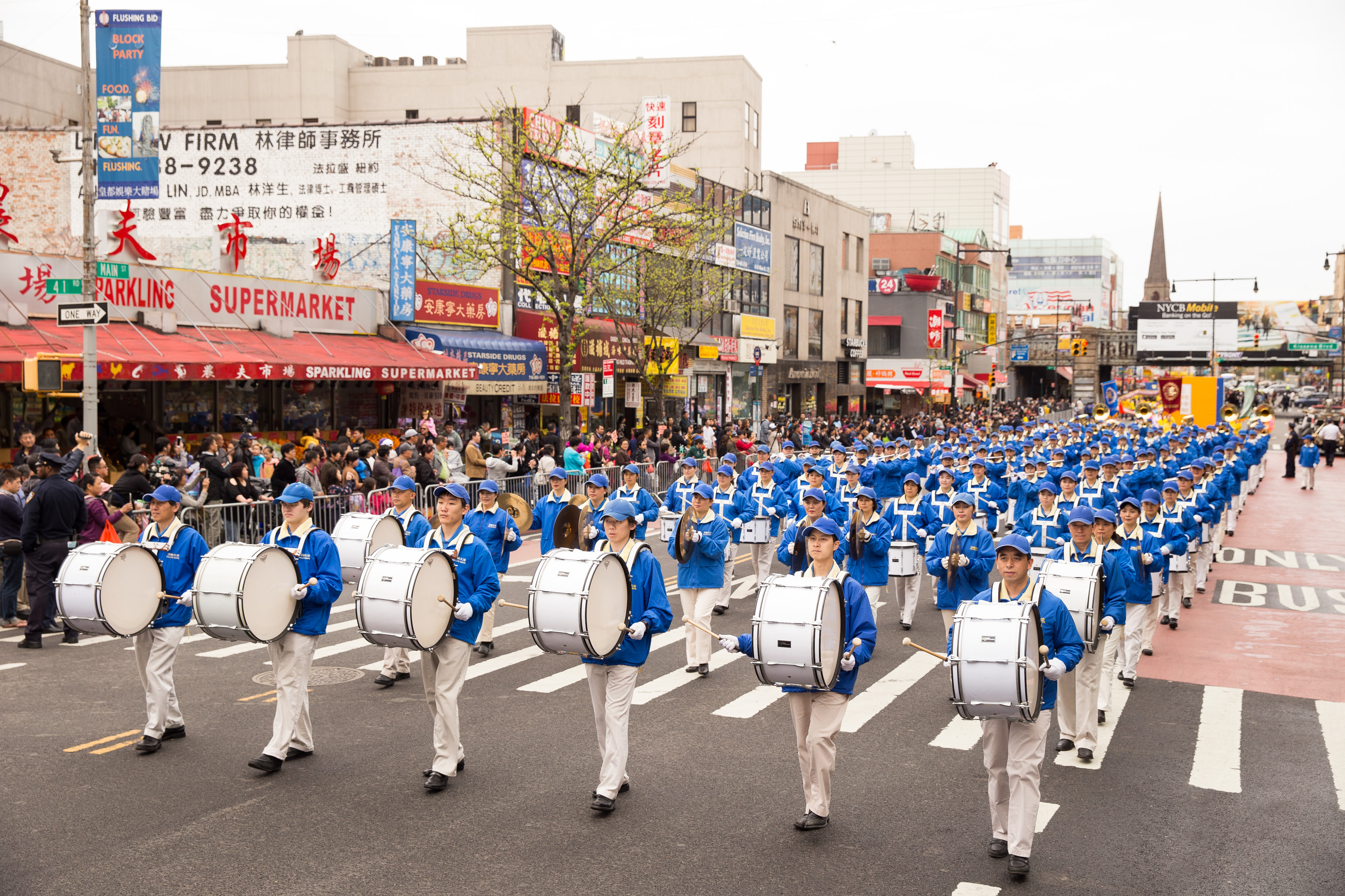 members of the Tian Guo marching band perform in the Flushing parade. (Larry Dye/Epoch Times)