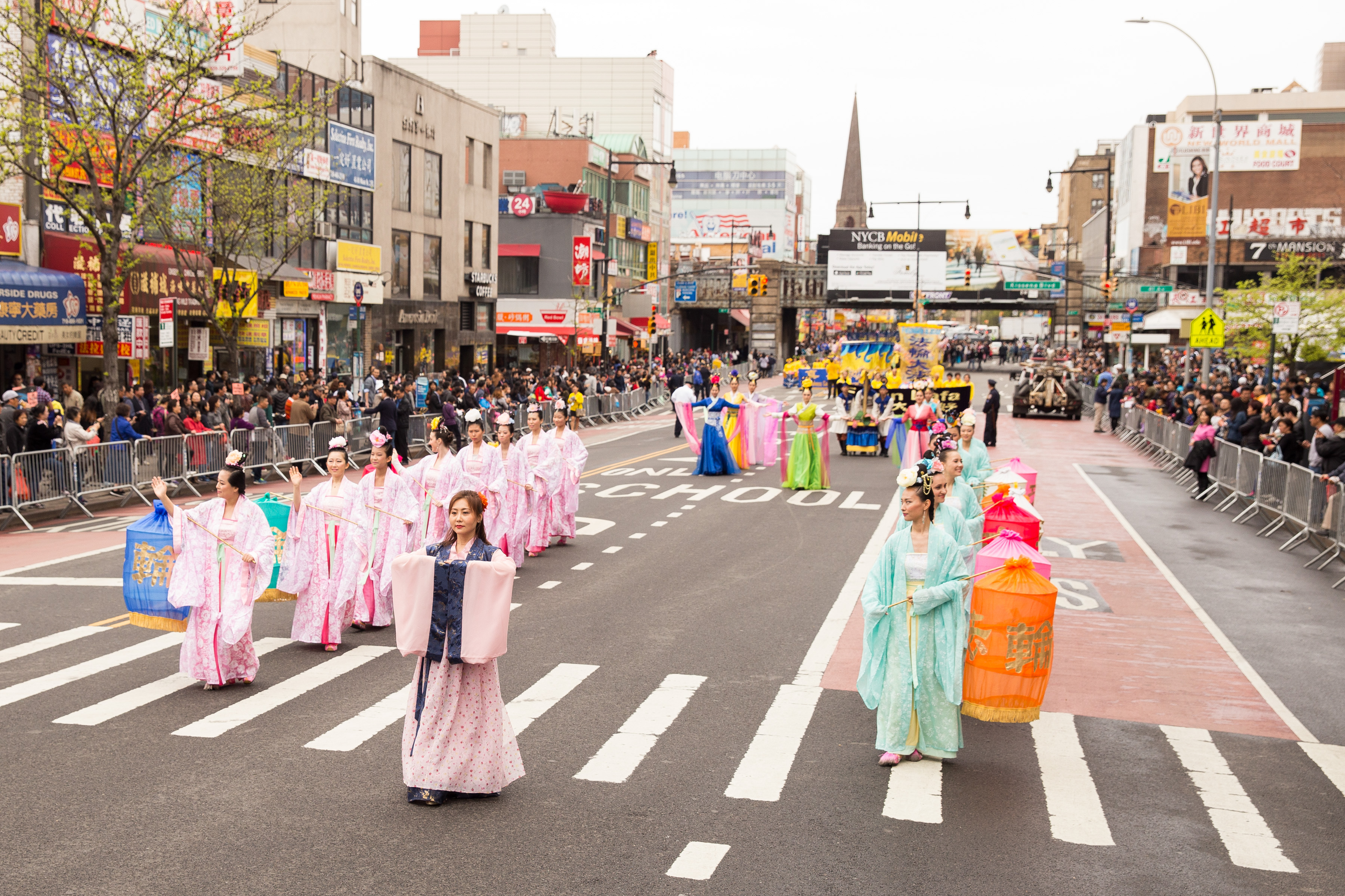 Falun Gong practitioners depict heavenly maidens in the Flushing parade. (Larry Dye/Epoch Times)