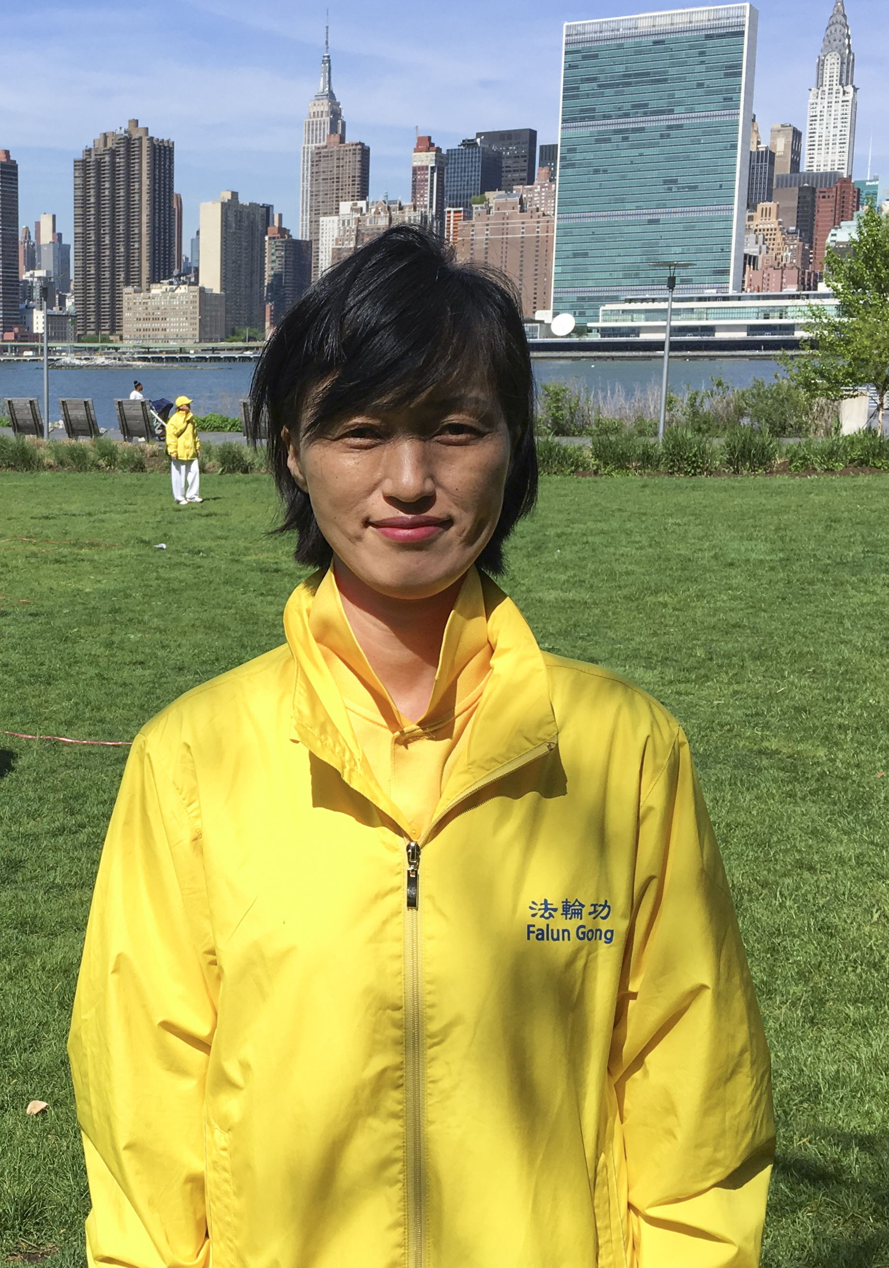 Choi Kyung-soon, a Falun Gong practitioner from South Korea, joins a character formation event at Gantry Plaza State Park on May 12, 2016. (Larry Ong/Epoch Times)