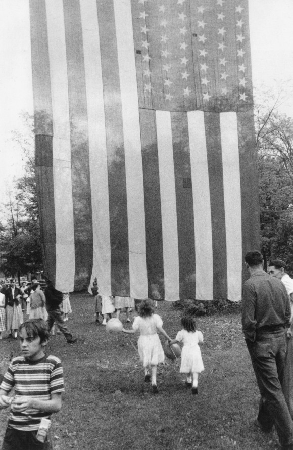 """""""Fourth of July — Jay, New York,"""" 1955-56, by Robert Frank. Photograph in his book, """"The Americans."""" 1958. (Robert Frank/PACE/MACGILL GALLERY)"""