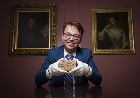 Dr Daniel Mansfield with the Plimpton 322 Babylonian clay tablet in the Rare Book and Manuscript Library at Columbia University in New York. (UNSW/Andrew Kelly)
